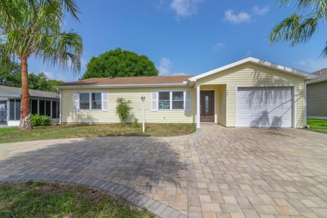 533 St Andrews Boulevard, Lady Lake, FL 32159 (MLS #558752) :: Bosshardt Realty