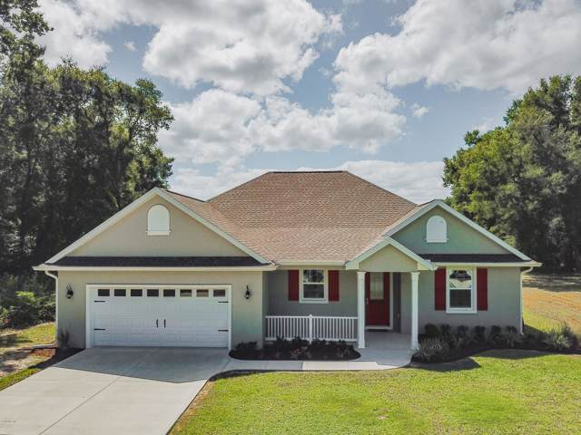 8252 SE 164th Place, Summerfield, FL 34491 (MLS #564024) :: Realty Executives Mid Florida
