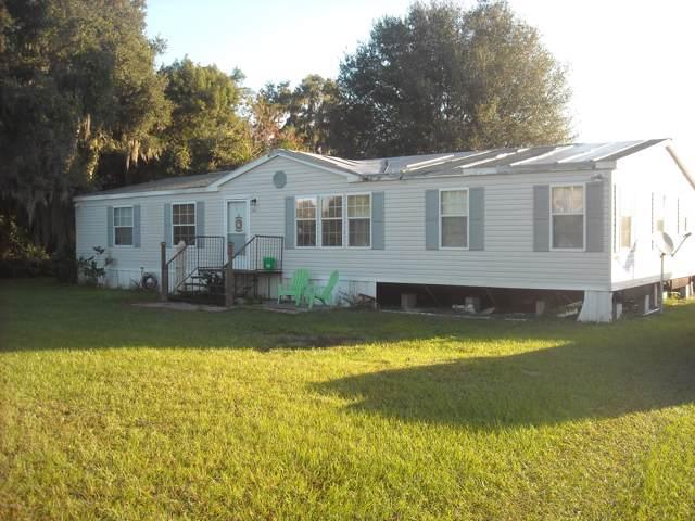 11860 SE Sunset Harbor Road, Weirsdale, FL 32195 (MLS #565837) :: Pepine Realty