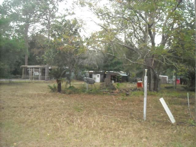 12877 NE 5th Lane, Silver Springs, FL 34488 (MLS #566970) :: The Dora Campbell Team