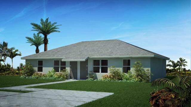 2241 NE 78th Lane, Ocala, FL 34479 (MLS #567054) :: The Dora Campbell Team