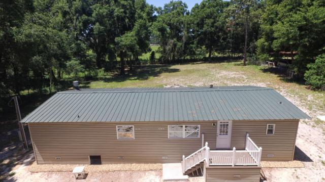 17550 SE 25th Terrace, Summerfield, FL 34491 (MLS #554860) :: The Dora Campbell Team