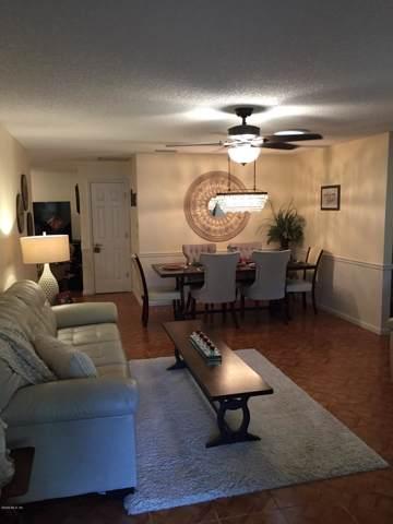 8775 SW 91st Place D, Ocala, FL 34481 (MLS #566946) :: The Dora Campbell Team