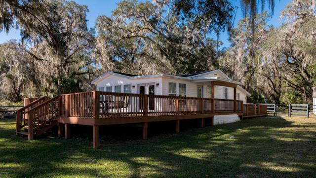 14135 NE 209TH Terrace, Fort Mccoy, FL 32134 (MLS #529567) :: Bosshardt Realty
