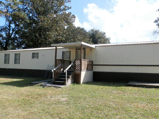 10671 SE 131st Lane, Ocklawaha, FL 32179 (MLS #542807) :: Bosshardt Realty