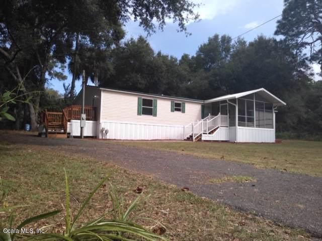 13215 SE 109th Terr., Ocklawaha, FL 32179 (MLS #562776) :: The Dora Campbell Team