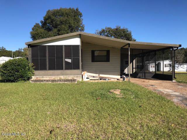 6785 NE 5th Place, Ocala, FL 34470 (MLS #567177) :: Bosshardt Realty