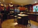 12136 Woodland Hills Drive - Photo 5