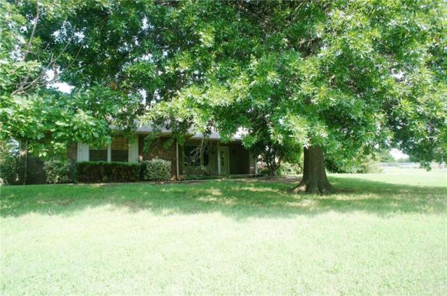 10712 Blue Fox Drive, Edmond, OK 73025 (MLS #833167) :: Wyatt Poindexter Group