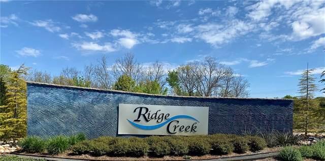 8201 Ridge Creek Drive, Edmond, OK 73034 (MLS #908665) :: Erhardt Group at Keller Williams Mulinix OKC