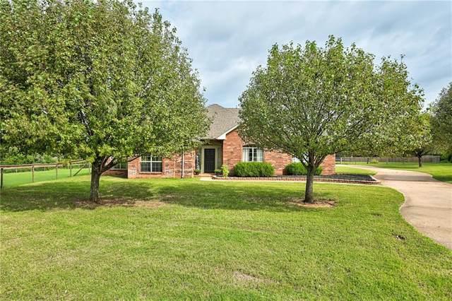 12051 Quail Ridge Circle, Edmond, OK 73034 (MLS #914137) :: Homestead & Co