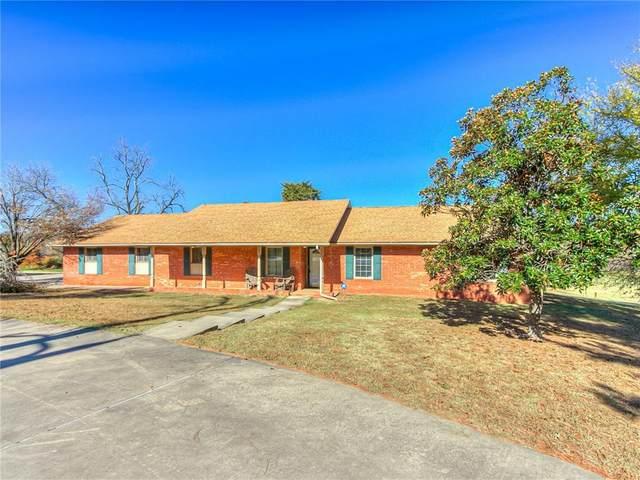11809 SE 128th Street, Oklahoma City, OK 73165 (MLS #934233) :: Homestead & Co