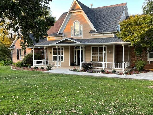 1042 Timberridge Road, Harrah, OK 73045 (MLS #975844) :: The UB Home Team at Whittington Realty