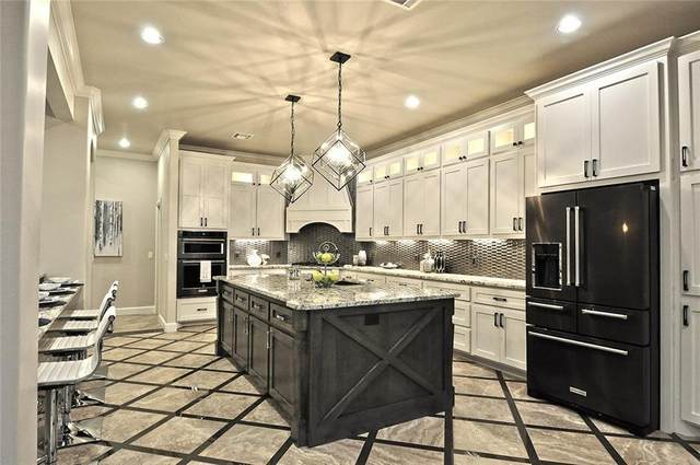 8325 NW 134th Terrace, Oklahoma City, OK 73142 (MLS #896214) :: Homestead & Co