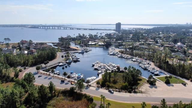 7112 Dolphin Bay Boulevard, Panama City Beach, FL 32407 (MLS #685524) :: Scenic Sotheby's International Realty
