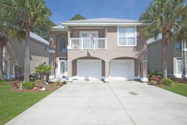 7009 N Lagoon Drive #106, Panama City Beach, FL 32408 (MLS #671551) :: ResortQuest Real Estate