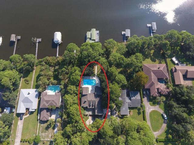 8701 N Lagoon Drive, Panama City Beach, FL 32408 (MLS #672785) :: Counts Real Estate Group