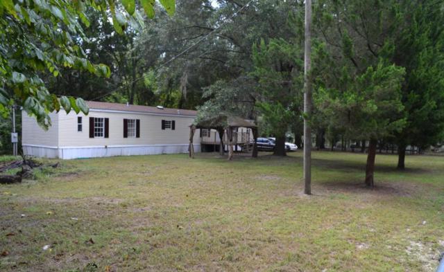 7740 Columbia Avenue, Southport, FL 32409 (MLS #675108) :: ResortQuest Real Estate