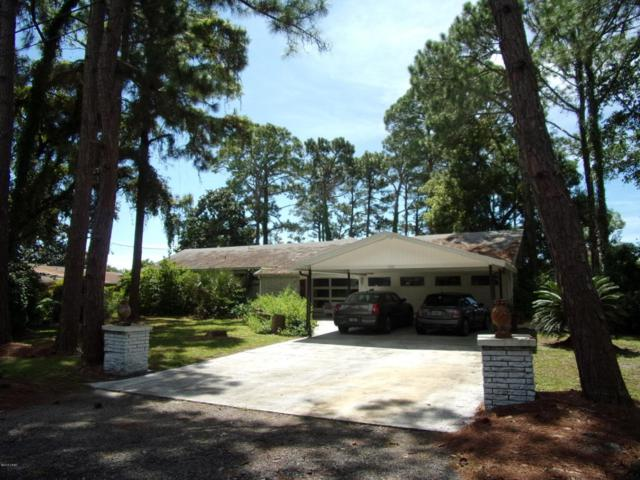 7301 Emerson Drive, Panama City Beach, FL 32408 (MLS #676307) :: Counts Real Estate Group