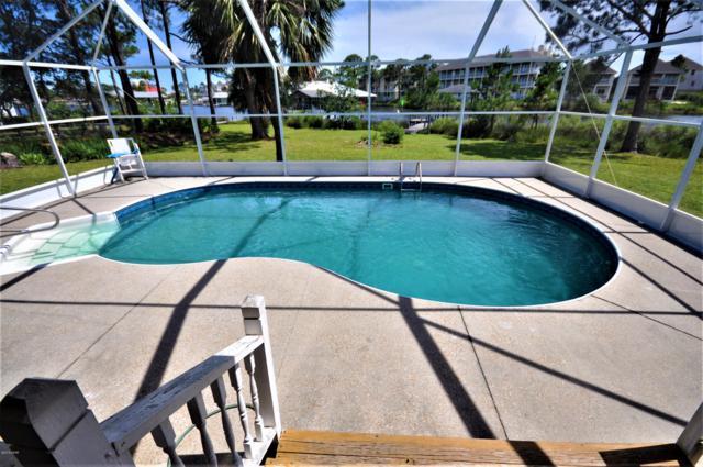 8753 N Lagoon Drive, Panama City Beach, FL 32408 (MLS #685552) :: Counts Real Estate Group