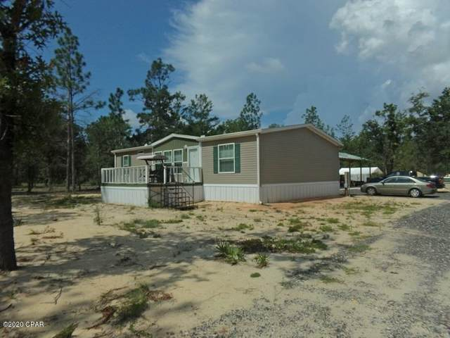 13711 Fiddlers Green Road, Southport, FL 32409 (MLS #699683) :: Keller Williams Realty Emerald Coast