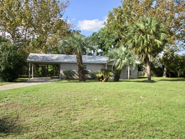 593 Lagoon Oaks Drive, Panama City Beach, FL 32408 (MLS #702443) :: Counts Real Estate Group, Inc.