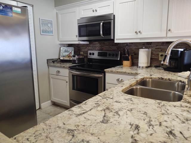 7205 Thomas Drive C403, Panama City, FL 32408 (MLS #703601) :: Counts Real Estate Group, Inc.