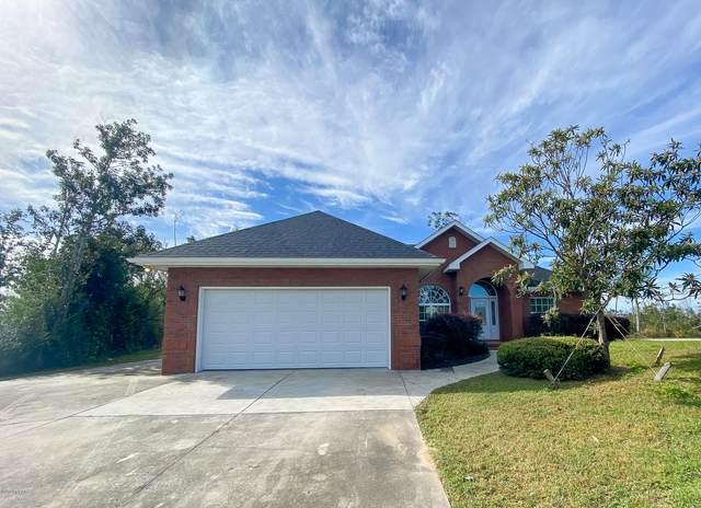 7701 Cambridge Court, Panama City, FL 32404 (MLS #704378) :: Anchor Realty Florida