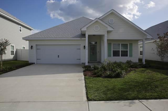 115 Moonraker Circle, Panama City Beach, FL 32407 (MLS #704761) :: Counts Real Estate Group
