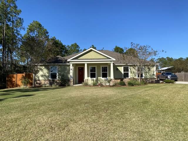 225 White Oaks Boulevard, Southport, FL 32409 (MLS #704959) :: The Ryan Group