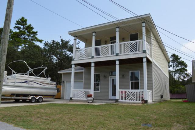 7110 N Lagoon Drive, Panama City Beach, FL 32408 (MLS #674311) :: ResortQuest Real Estate