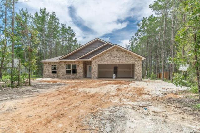 1921 Oakcrest Lane, Southport, FL 32409 (MLS #674884) :: ResortQuest Real Estate