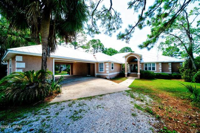 8753 N Lagoon Drive, Panama City Beach, FL 32408 (MLS #715436) :: Counts Real Estate Group