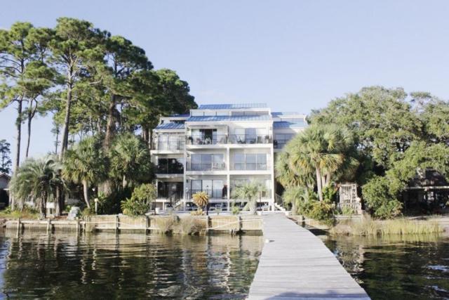 6135 N Lagoon Drive #102, Panama City Beach, FL 32408 (MLS #664199) :: Keller Williams Success Realty
