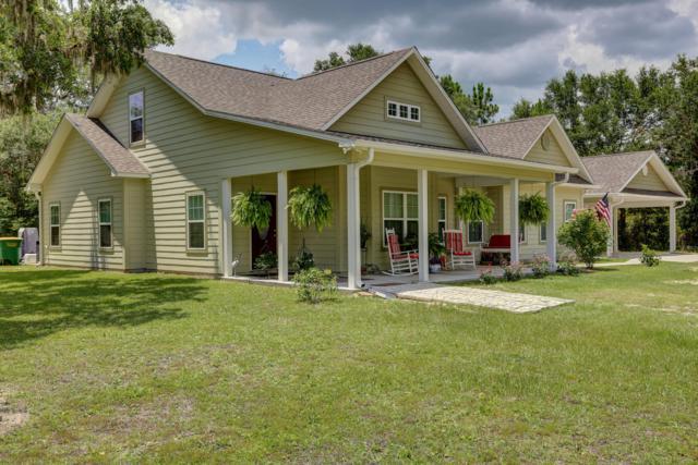7101 Paul Conrad Drive, Southport, FL 32409 (MLS #673863) :: ResortQuest Real Estate