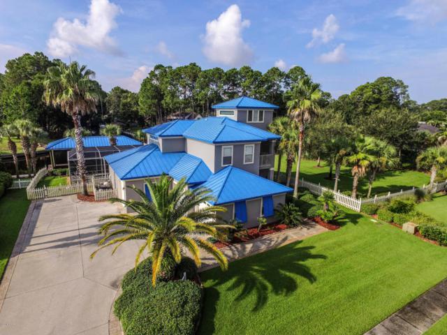 7123 Dolphin Bay Boulevard, Panama City Beach, FL 32407 (MLS #675323) :: ResortQuest Real Estate