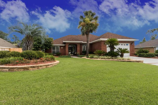 7110 Dolphin Bay Boulevard, Panama City Beach, FL 32407 (MLS #685817) :: ResortQuest Real Estate