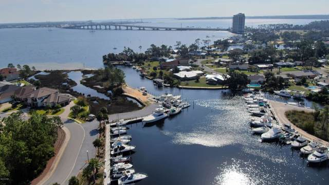 7106 Dolphin Bay Boulevard, Panama City Beach, FL 32407 (MLS #690166) :: Scenic Sotheby's International Realty