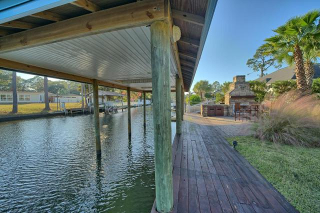 7121 Dolphin Bay Boulevard, Panama City Beach, FL 32407 (MLS #665611) :: Keller Williams Success Realty