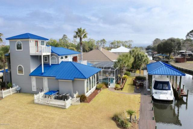 7123 Dolphin Bay Boulevard, Panama City Beach, FL 32407 (MLS #665632) :: Berkshire Hathaway HomeServices Beach Properties of Florida