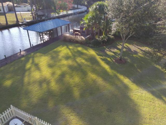 7121 Dolphin Bay Boulevard, Panama City Beach, FL 32407 (MLS #665611) :: Berkshire Hathaway HomeServices Beach Properties of Florida