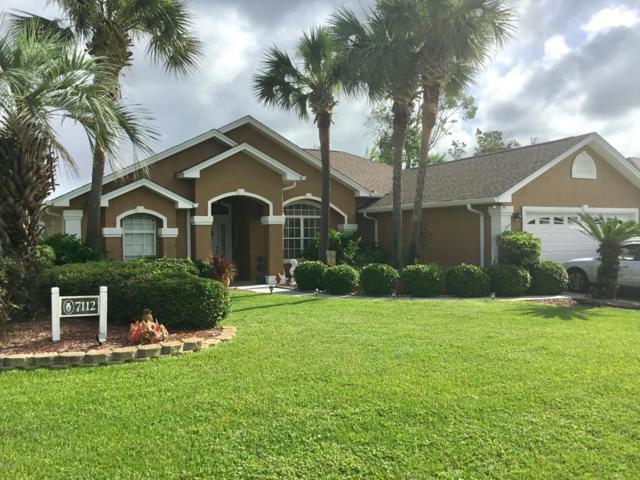 7112 Dolphin Bay Boulevard, Panama City Beach, FL 32407 (MLS #685524) :: ResortQuest Real Estate