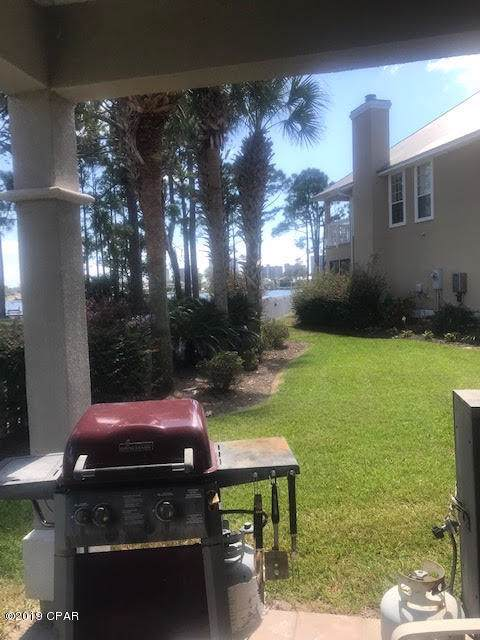 7009 N Lagoon Drive #113, Panama City Beach, FL 32408 (MLS #688484) :: CENTURY 21 Coast Properties