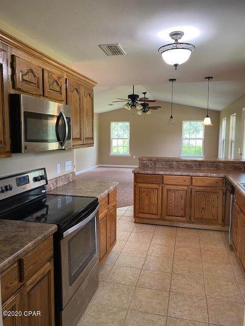6655 Grande Oak Loop, Grand Ridge, FL 32442 (MLS #699684) :: Keller Williams Realty Emerald Coast