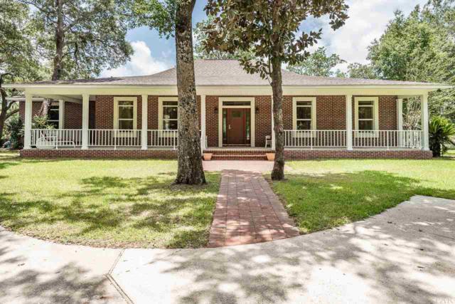 6921 East Bay Blvd, Navarre, FL 32566 (MLS #557248) :: ResortQuest Real Estate