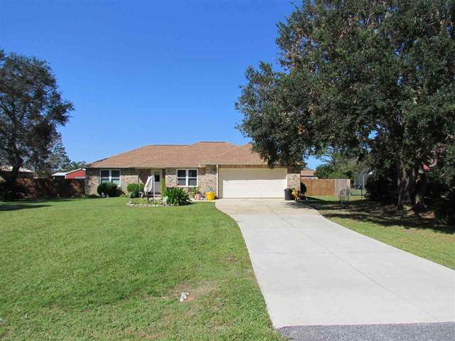 1889 Commodore Dr, Navarre, FL 32566 (MLS #579285) :: Levin Rinke Realty