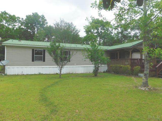 6390 Albritton Rd, Walnut Hill, FL 32568 (MLS #572512) :: Levin Rinke Realty