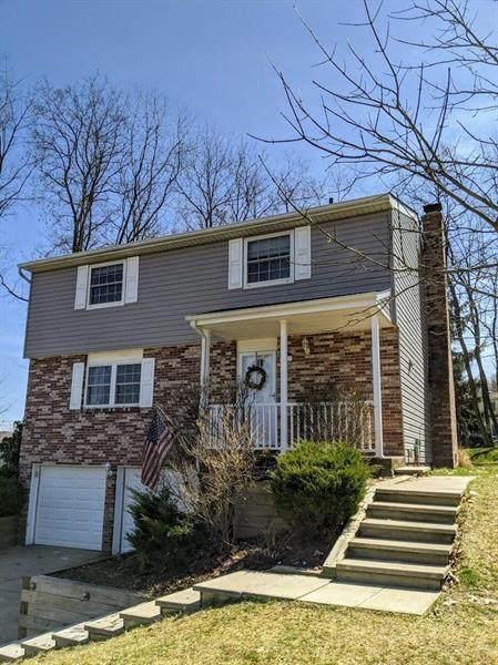 107 Beechwood Cir, Cranberry Twp, PA 16066 (MLS #1441774) :: Broadview Realty
