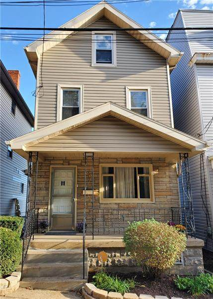 909 Haslage Ave, Spring Hill, PA 15212 (MLS #1527242) :: The SAYHAY Team