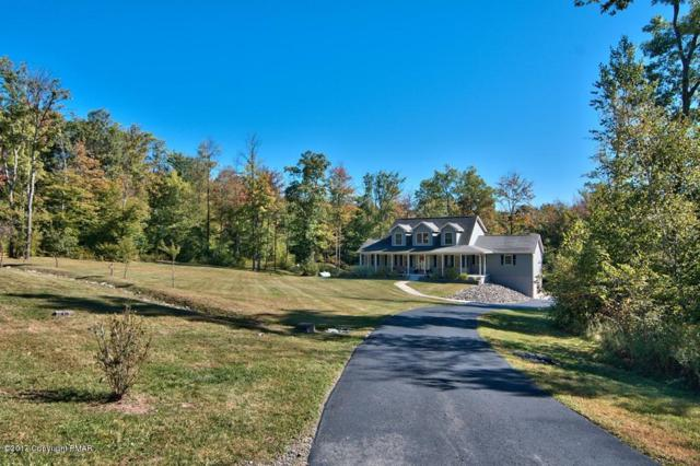 521 Summit Woods Rd, Roaring Brook Twp, PA 18444 (MLS #PM-51598) :: RE/MAX of the Poconos